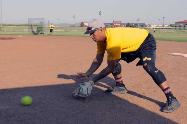 Spc. David Romero, Fort Campbell, Ky., fields grounders during practice Aug. 31, 2017 at Fort Sill, Okla. Seventeen veterans and eight rookies were invited to the tryouts at the Maj. Gen. Dinges Sports Complex.