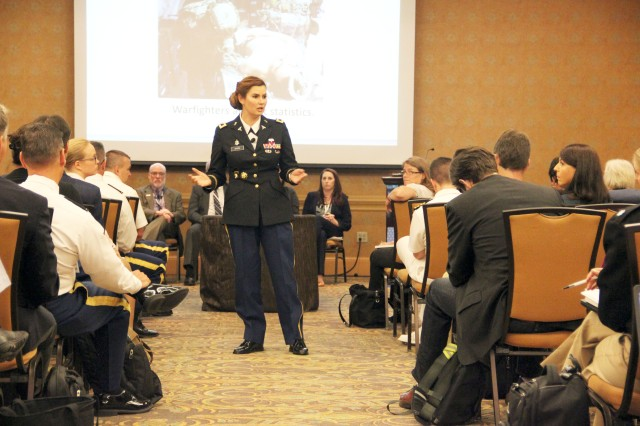 U.S. Army Medical Materiel Agency Commander Col. Lynn Marm addresses the crowd during a panel session at the Military Health System Research Symposium Aug. 29 in Kissimee, Florida.  The panel session focused on challenges in getting medical products to the field.