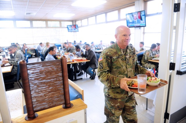 PRESIDIO OF MONTEREY, California -- Lt. Gen. Kenneth Dahl, commanding general of Installation Management Command, makes his way to his table with his lunch at Belas Dining Facility Aug. 22.
