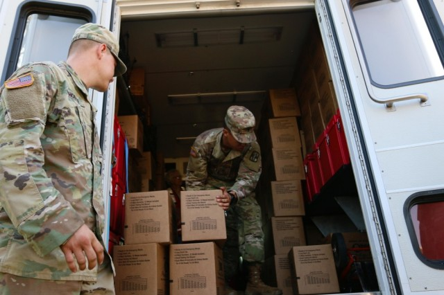 Soldiers assigned to the 36th Engineer Brigade and 1st Medical Brigade, organize a boxes of meals, ready-to-eat (MRE) in an American Red Cross Emergency Response Vehicle as part of a Supply Delivery Operation where their unit supplied 32,000 MREs to Beaumont, Texas, Sept. 1. The Army Corps of Engineers is also involved in extensive efforts to prepare for Hurricane Irma.