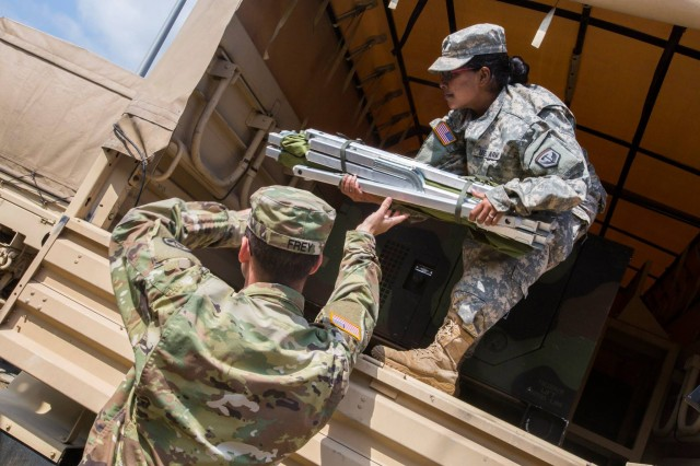 Soldiers with the 253rd Transportation Company load cots on a light medium tactical vehicle as more than 130 New Jersey Army National Guard Soldiers at Cape May Courthouse, N.J., prepare to deploy to support the Florida National Guard in anticipation of Hurricane Irma Sept. 7, 2017.