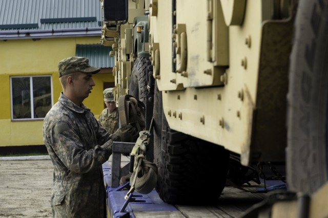 Spc. Christopher Woods, a wheeled vehicle mechanic assigned to the 45th Infantry Brigade Combat Team, Oklahoma Army National Guard, currently stationed at Joint Multinational Training Group-Ukraine, assisted with receiving and downloading Humvees, as part of Rapid Trident 17, at the International Peacekeeping and Security Center, Sept. 8, 2017 in Yavoriv, Ukraine. Rapid Trident 17 will provide participating nations with the opportunity to improve theater security cooperation within Eastern Europe, enhance interoperability amongst NATO Allies and partners, and combine capabilities to operate in joint, multinational and integrated security operations. (U.S. Army photo by Sgt. Justin Geiger)