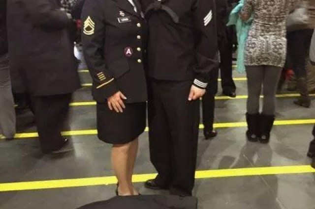 Sgt. 1st Class Miriam Lemus, presently Senior Operations and Training NCO with U.S. Army Human Resources Command's Casualty and Mortuary Affairs Operations Division, poses for a photo with her brother, Pedro Lemus Jr., at the Great Lakes Naval Training Center Dec. 3, 2014, the day he graduated from Navy Basic Training.