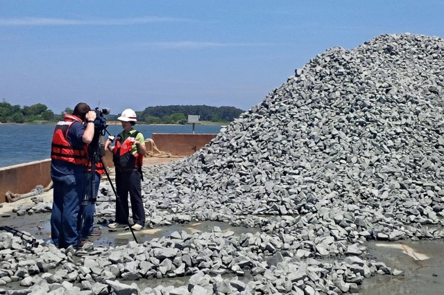 Angie Sowers, Baltimore District, Integrated Water Resources management specialist, is interviewed by ABC's local affiliate reporter Amy Aubert on oyster restoration efforts at Harris Creek in May 2015. Rocks used for restoration of reefs and quarried from Havre De Grace, Maryland, are seen on the barge. Harris Creek will be the first restored Chesapeake Bay tributary in Maryland.
