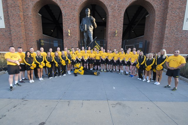 University of Iowa ROTC cadets, their instructors, the U of I Spirit Squad and the Hawkeyes mascot 'Herky' gather at 7 a.m. Sept. 8 in front of Kinnick Stadium, Iowa City, Iowa.