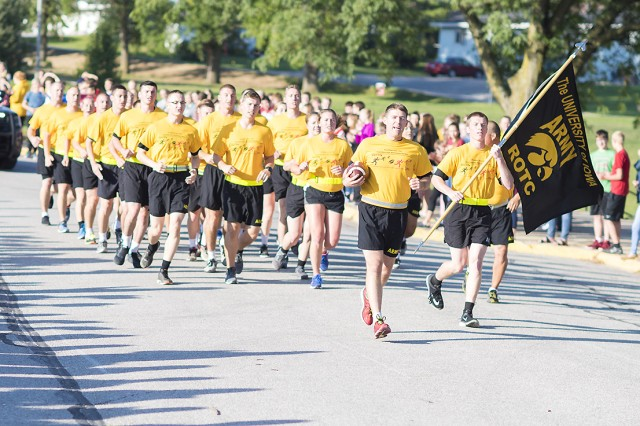 Cadet Nathan Dittner, University of Iowa ROTC battalion commander, leads the way with the Cyclone-Hawkeye game ball during the annual Game Ball Run Sept. 8 at Williamsburg High School, Williamsburg, Iowa.