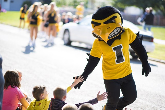 The University of Iowa Hawkeyes' mascot 'Herky' greets elementary school children Sept. 8 in Belle Plaine, Iowa.
