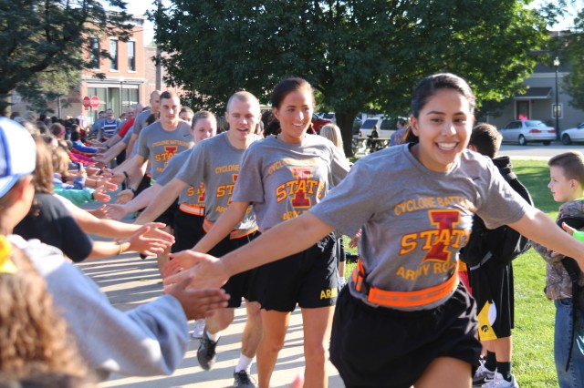 Iowa State University ROTC cadets run through State Center, Iowa, during the annual Game Ball Run Sept. 8.