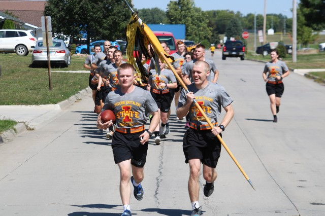 David Pauls, Iowa State University ROTC cadet battalion commander, leads the way with the Cyclone-Hawkeye game ball during the annual Game Ball Run Sept. 8 in Tama, Iowa.