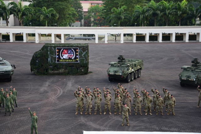 The 25th Infantry Division, 29th Infantry Brigade Combat Team Hawaii Army National Guard alongside Singapore Armed Forces participate in an opening ceremony for exercise Tiger Balm 2017 in Singapore Jul. 18, 2017. Celebrating its 37th consecutive year, this exercise enhances the professional relationship, combat readiness, and interoperability between the United States and Singapore Armies to meet and demonstrate regional security, partnership and resolve. This two-week long bilateral exercise is hosted in Hawaii on even years and in Singapore on odd years.  Concurrently, this exercise is held at multiple locations in Singapore, Hawaii and Alaska with U.S. Command Post Exercise response cells at several locations. Soldiers utilize cyber war-gaming during this exercise and for the first time, Strykers and Terrex military vehicles are training and performing side by side.
