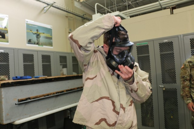 Spc. Brandon Walker, a chemical, biological, radiological and nuclear (CBRN) specialist with 6th Squadron, 8th Cavalry Regiment, 2nd Infantry Brigade Combat Team, 3rd Infantry Division, demonstrates the proper employment of the M51 gas mask during CBRN training, July 11, 2017, at Fort Stewart, Ga. The training improves and maintains combat readiness and builds Troopers' confidence when fighting in a chemical, biological, radiological and nuclear environment. (U.S. Army photo by Sgt. John Onuoha / Released)
