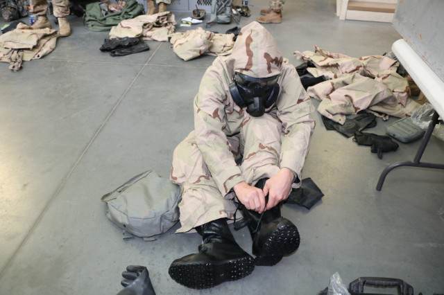 Spc. Brandon Walker, a chemical, biological, radiological and nuclear specialist with 6th Squadron, 8th Cavalry Regiment, 2nd Infantry Brigade Combat Team, 3rd Infantry Division, demonstrates the proper way to wear a Joint Service Lightweight Integrated Suit Technology (JSLIST) during CBRN training, July 11, 2017, at Fort Stewart, Ga. The training improves combat readiness and builds Troopers' confidence when fighting in a chemical, biological, radiological and nuclear environment. (U.S. Army photo by Sgt. John Onuoha / Released)