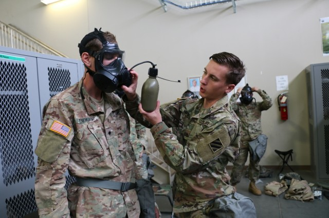 Troopers of 6th Squadron, 8th Cavalry Regiment, 2nd Infantry Brigade Combat Team, 3rd Infantry Division demonstrate how to connect a canteen to an M51 gas mask during chemical, biological, radiological and nuclear training, July 11, 2017, at Fort Stewart, Ga. The training improves and maintains combat readiness and builds Troopers' confidence when fighting in a chemical, biological, radiological and nuclear environment. (U.S. Army photo by Sgt. John Onuoha / Released)