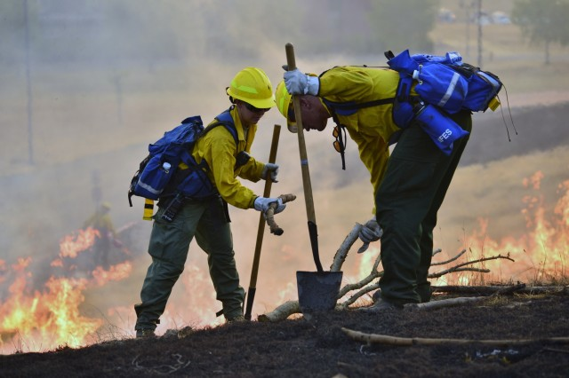 Oregon Army National Guard Soldiers work together during a wildland fire field training exercise held at the Oregon Department of Public Safety Standards (DPSST) and Training in Salem, Oregon, August 28, 2017. Nearly 125 Citizen-Soldiers from the 41st Infantry Brigade Combat Team volunteered for the second iteration (also known as NG-2) of Oregon National Guard personnel called-up to assist with wildfires across the state of Oregon. They attended a four-day training certification at DPSST where they received training on hose lays, deploying fire shelters, how to assess and mitigate hot spots, protecting structures and understanding fire behavior.