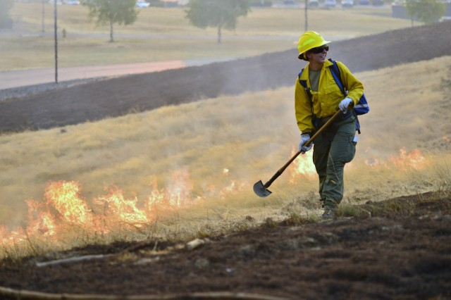 An Oregon Army National Guard Soldier from the 41st Infantry Brigade Combat Team experiences the heat of a controlled burn during a field training exercise at the Oregon Department of Public Safety Standards and Training in Salem, Oregon, August 28, 2017. The exercise was part of their four-day training certification before being dispatched to wildland fires across the state. The Soldiers received training on hose lays, deploying fire shelters, how to assess and mitigate hot spots, protecting structures and understanding fire behavior.