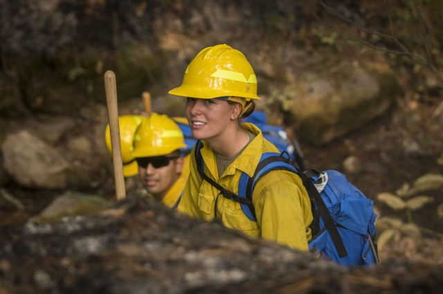 A U.S. Army Soldier assigned to 23rd Brigade Engineer Battalion, 1-2 Stryker Brigade Combat Team, completes initial tactical training with civilian firefighters working with the U.S. Forest Service in the Umpqua National Forest, Umpqua North Complex, Oregon, Sept. 8. The Soldiers were taught to check for hot spots under the scorched forest floor, by feeling for heat with the backs of their hands. This technique is known as cold trailing. (U.S. Army photos by Pvt. Adeline Witherspoon, 20th Public Affairs Detachment)