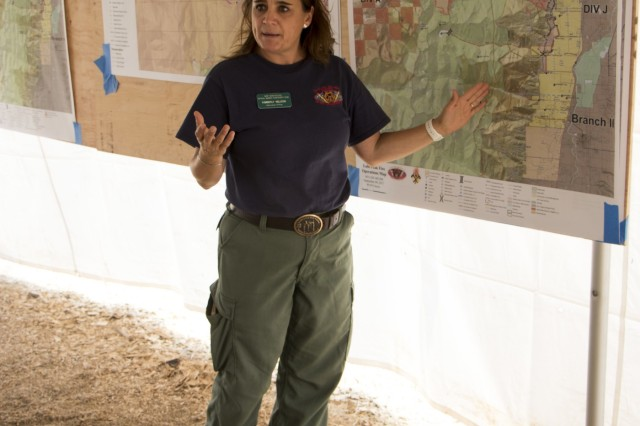 Kimberly Nelson, Public Information Officer for the Lolo Peak Fire, explains the behavior and activity of the fire during a tour of base camp on September 9, 2017. The Lolo fire has burned over 50,000 acres and has cost the state millions of dollars.