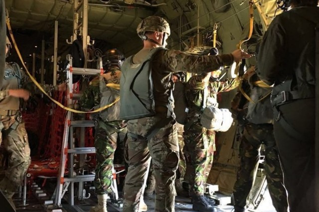 Staff Sgt. Daniel Pedregon and Sgt. Nicholas August perform safety duties during a Romanian airborne operation, Aug. 25, 2017. Twelve paratroopers of 16th Special Troops Battalion conducted airborne operations alongside more than 220 Romanian paratroopers and jumpmasters.