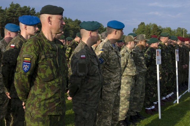 Lithuanian, Polish, Ukrainian and Turkish Soldiers stand shoulder-to-shoulder in formation during the official opening ceremony for Exercise Rapid Trident 17 in Yavoriv, Ukraine, Sept. 11, 2017.  Rapid Trident 17 will provide participating nations with the opportunity to improve theater security cooperation within Eastern Europe, enhance interoperability amongst NATO member nations and partners, and to combine capabilities to operate in joint, multinational and integrated security operations. (U.S. Army photo by Sgt. Justin Geiger)