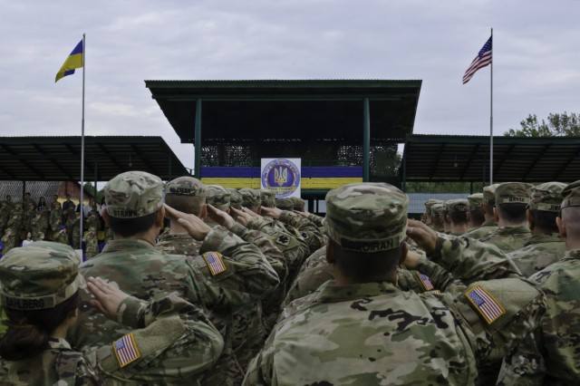 U.S. National Guard Soldiers salute the American Flag during the National Anthem as part of the official opening ceremony for Exercise Rapid Trident 17 in Yavoriv, Ukraine, Sept. 11, 2017. Rapid Trident 17 will provide participating nations with the opportunity to improve theater security cooperation within Eastern Europe, enhance interoperability amongst NATO member nations and partners, and to combine capabilities to operate in joint, multinational and integrated security operations. (U.S. Army photo by Sgt. Justin Geiger)