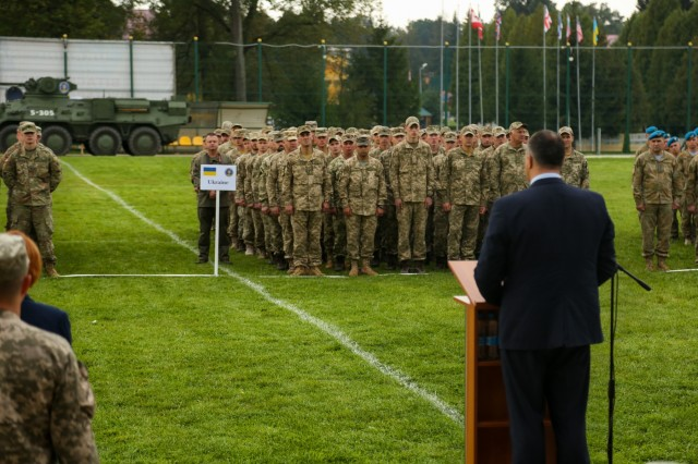 Oleksandr Hanushchyn, the Head of Lviv Oblast Council, addresses the participating members of Rapid Trident 17 at the International Peacekeeping and Security Centre in Yavoriv, Ukraine, Sept. 11, 2017. Rapid Trident 17 will provide participating nations with the opportunity to improve theatre security cooperation within Eastern Europe, enhance interoperability amongst NATO members and partners, and to combine capabilities to operate joint, multinational and integrated security operations. (U.S. Army photo by Pfc. Zachery Perkins)