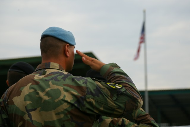 A Moldovan soldier salutes the United States flag while conducting the opening ceremony for Rapid Trident 17 at the International Peacekeeping and Security Centre in Yavoriv, Ukraine, Sept. 11, 2017. Rapid Trident 17 will provide participating nations with the opportunity to improve theatre security cooperation within Eastern Europe, enhance interoperability amongst NATO members and partners, and to combine capabilities to operate joint, multinational and integrated security operations. (U.S. Army photo by Pfc. Zachery Perkins)