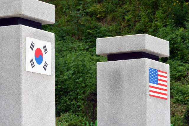 The Korean and American flags are displayed on the top of the columns of The Splendor of Peace and Freedom monument located near Jochiwon, South Korea.