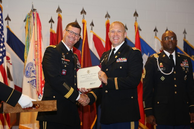 U.S Army Chief of Transportation Brig. Gen Jeffrey W. Drushal presents Capt. Frederick Teeter his award for his selection as the Transportation Corps Army officer of the Year on July 12 at Fort Lee Va. Teeter serves as the G5 planner for the 8th Theater Sustainment Command at Fort Shafter, Hawaii and is a former Assistant Professor of Military Science at Wake Forest University and Winston Salem State University.