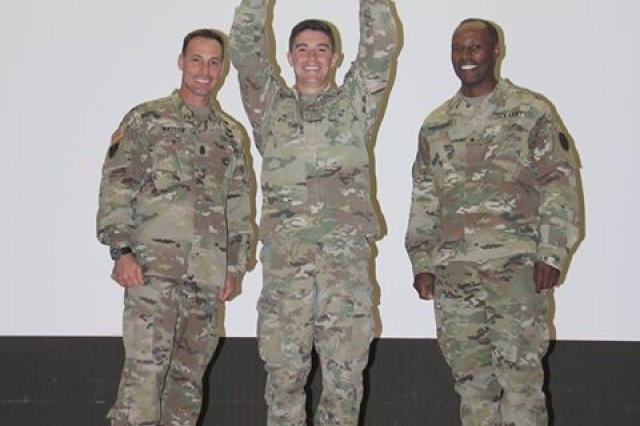 After the grueling Pacific Best Medic competition, 2nd Lt. Adam Schafer was able to hold the 1st place trophy high up standing between Brig. Gen. Bertram Providence, commander, Regional Health Command -- Pacific (RHC-P) and Command Sgt. Maj. Richard F. Watson III, RHC-P senior enlisted advisor.