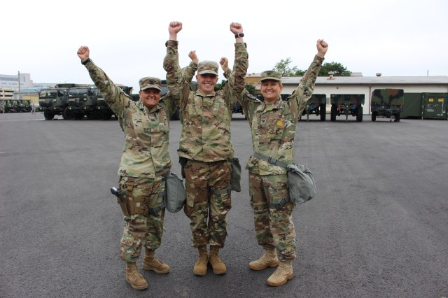 Capt. Erika Rosales, Bravo Company Commander and Col. Erica Clarkson, 121st Combat Support Hospital commander congratulate 2nd Lt. Adam Schafer when he returned to Korea after the Pacific Best Medic Competition.