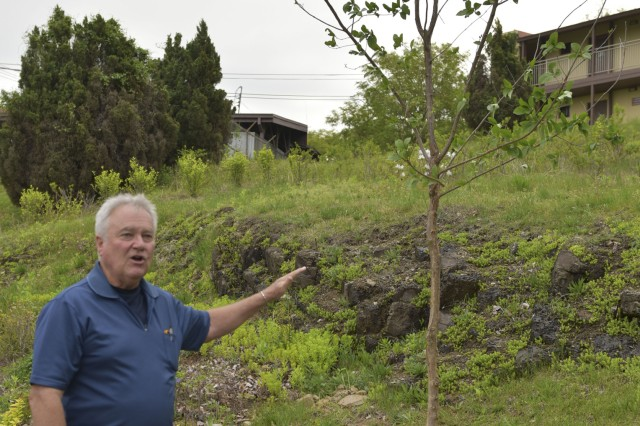 Tom Kunneke discusses the importance of trees after planting it during the 2016 Earth Day, April 29, 2016 at Camp Carroll.