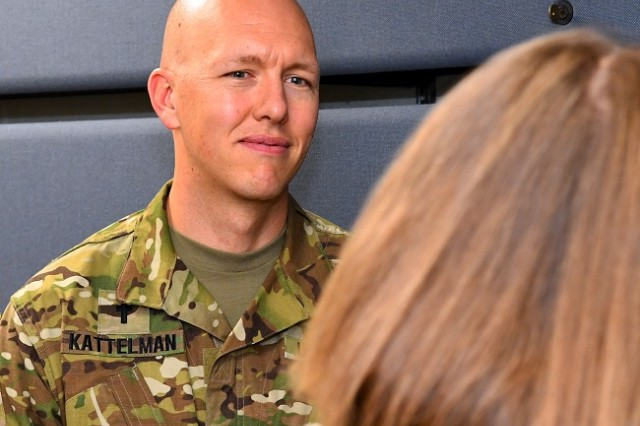 Chaplain (Maj.) Brad Kattelmann talks with a fellow Soldier during a recent meeting at the Military Surface Deployment and Distribution Command headquarters.