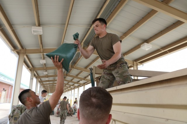 Soldiers of 1st Battalion, 30th Infantry Regiment, 2nd Infantry Brigade Combat Team, 3rd Infantry Division, prepare for Hurricane Irma, Sept. 8, at Fort Stewart, Georgia. The Army and other service branches are now involved in extensive relief and recovery efforts following the storm.