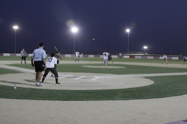 170904-A-RW053-015 Troops enjoy their first game on a new softball field after a ribbon-cutting zone 1 at Camp Arifjan, Kuwait, on September 04, 2017. The new field features an AstroTurf infield and outfield plus a 252 ft. home run fence. The field provides valuable recreational experiences for the soldiers. (U.S. Army photo by Sgt. 1st Class Charles Highland)