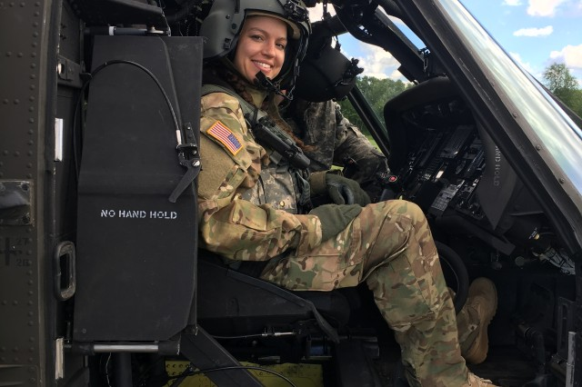 1st  Lt. Sophia Matias, 27, now commander of Headquarters and Headquarters Company, a unit that includes battalion staff and flight operations specialists with the Illinois National Guard in Peoria, Illinois. She is in charge of planning battalion-level operations. What she loves most, however, is flying the Black Hawk.