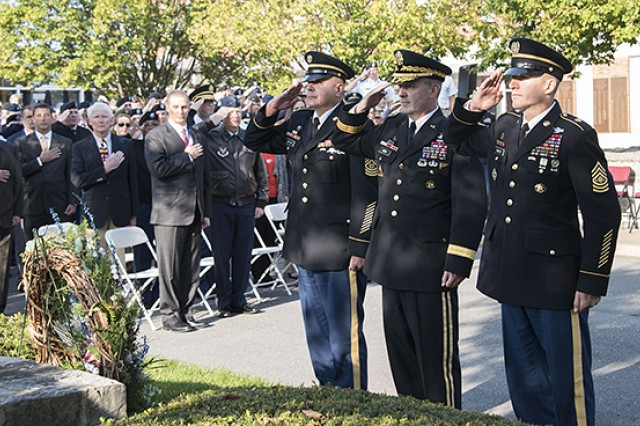 Gen. John Kem and Sergeant Major of the Army Daniel Dailey salute as Taps plays to honor the lives lost on Sept. 11, 2001, and in the following years of worldwide operations. The wreath laying was a part of a Patriot Day ceremony held in front of the war college's Root Hall Monday.