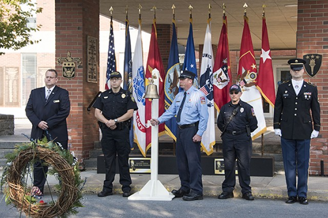 Representing civilians, first responders and military personnel, Todd Wheeler, Roy Carte, David Myers, Richard Lewis and Staff Sgt. Brian Bartko each ring a bell in remembrance of the events of Sept. 11, 2001. The ringing of the bell was part of a Patriot Day ceremony held Monday at the Army War College to honor the lives lost on Sept. 11, and in the year of worldwide operations.