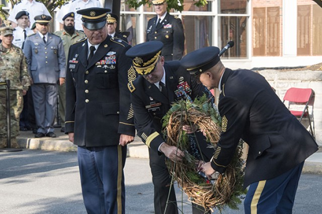 Army War College Command Sergeant Major Christopher Martinez, USAWC Commandant Maj. Gen. John Kem and Sergeant Major of the Army Daniel Dailey lay a wreath in front of the war college's Root Hall Monday. Monday's wreath laying was part of the Army War College's Patriot Day ceremony held in honor of the lives lost in the events of Sept. 11, 2001 and subsequent 16 years of worldwide operations.