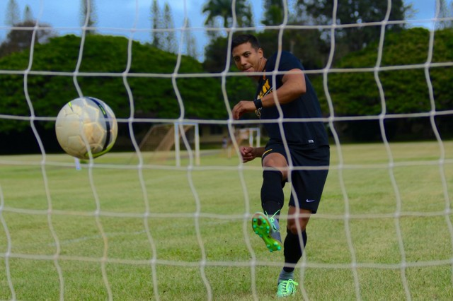 During a practice session, 1st Lt. Anthony Uriarte, a medical service officer with the 25th Sustainment Brigade, 25th Infantry Division, strikes his soccer ball into a net Aug. 28, 2017.