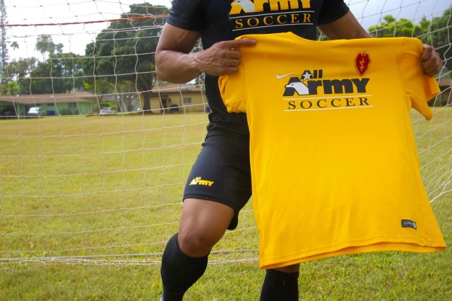 Two time All-Army Soccer veteran 1st Lt. Anthony Uriarte, a medical service officer with the 25th Sustainment Brigade, 25th Infantry Division, stands for a photo Aug. 28, 2017, with the jerseys he wore while competing with his team.