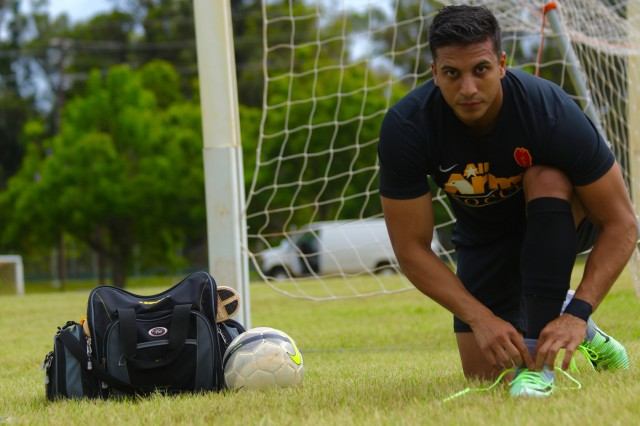 Two time All-Army Soccer veteran 1st Lt. Anthony Uriarte, a medical service officer with the 25th Sustainment Brigade, 25th Infantry Division, laces his soccer cleats Aug. 28, 2017, before he begins his practice.
