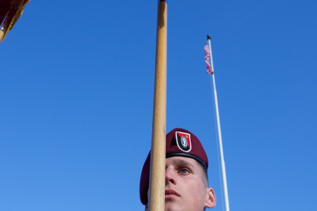Spc. Justin Eggers, 6th Brigade Engineer Battalion, bears the colors of 4th Brigade Combat Team (Airborne), 25th Infantry Division, during a Sept. 8, 2017, brigade deployment ceremony at Joint Base-Elmendorf-Richardson. The Spartan Brigade is set to deploy to Afghanistan. (U.S. Air Force photo by David Bedard)