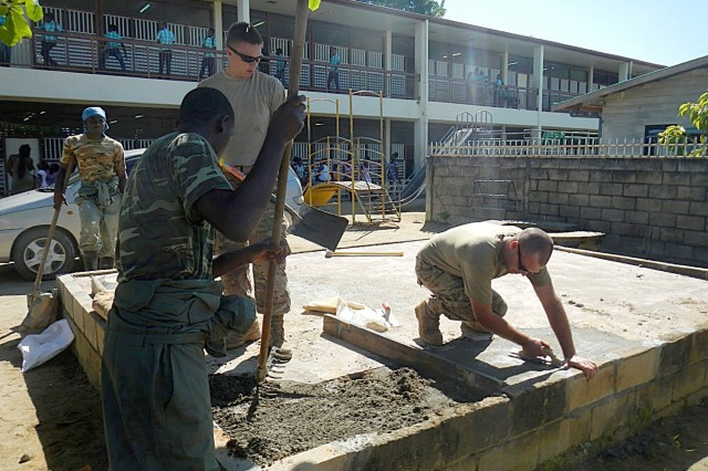 Soldiers from the South Dakota Army National Guard and members of the Suriname Defense Force repair a concrete foundation while renovating portions of the O.S. Majosteeg 3 School in Paramaribo, Aug. 13-24. The renovation project, part of the Suriname and South Dakota State Partnership Program, provided an annual training opportunity for SDARNG engineer units and further developed partnerships with Suriname Defense Forces, while simultaneously assisting with a community need.