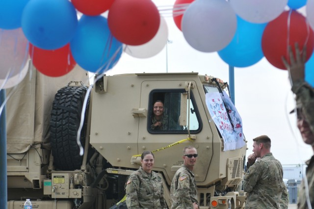 Spc. Rainey Jackson, one half of a two-Soldier wedding, hides in a Medium Tactical Vehicle prior to exchanging her vows at Regional Support Area Beaumont, Texas, Sept. 9, 2017. Jackson and her husband-to-be, Cpl. Donald Hamilton, are with units from the 45th Infantry Brigade Combat Team, Oklahoma Army National Guard, and were activated to support Hurricane Harvey recovery efforts in Texas along the gulf coast.