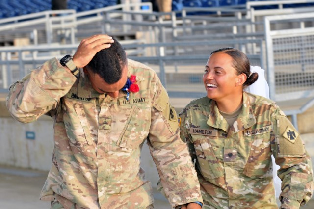 Oklahoma Army National Guard newlyweds Cpl. Donald Hamilton, left, and Spc. Rainey Hamilton laugh as the corporal tries to brush birdseed out of his hair after their wedding at Regional Support Area Beaumont, Texas, Sept. 12, 2017. Both were activated by their home state to assist recovery efforts in Texas after Hurricane Harvey hit the gulf coast area.