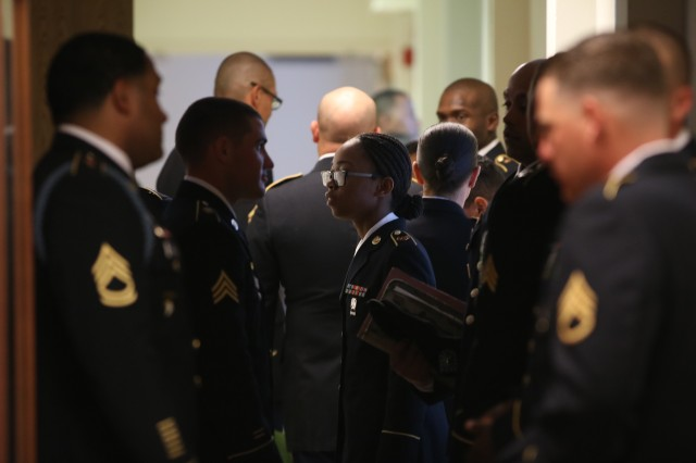 Soldiers and their sponsors wait quietly before they enter the Regimental Command Room Aug. 25 to compete for Soldier and NCO of the Quarter at Fort Sill, Okla.
