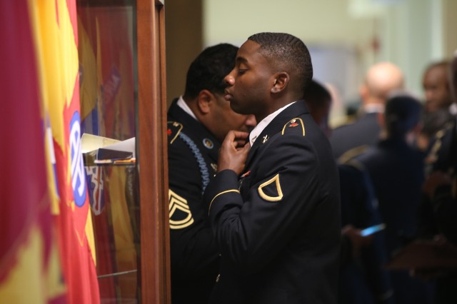 A Soldier checks his uniform before he is faced with leaders who will judge his appearance and question his knowledge on uniform regulation.
