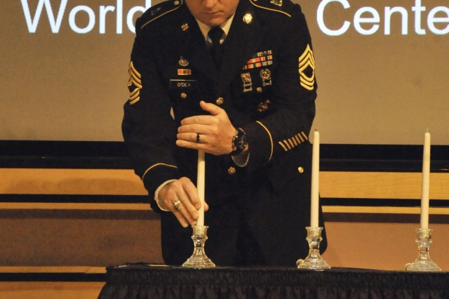 The U.S. Army Sergeants Major Academy and Sergeants Major Course Class 68 paid its respects in remembrance to those who lost their lives in the September 11, 2001 terrorist attack. Above, Class 68 member, Master Sgt. David R. O'Dea, lights a candle in remembrance of those who perished at the World Trade Center towers 1 and 2.