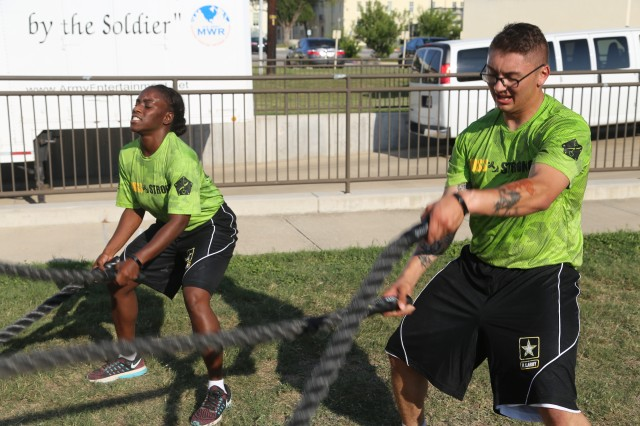 Soldier demonstrate power derived from technique at PT session