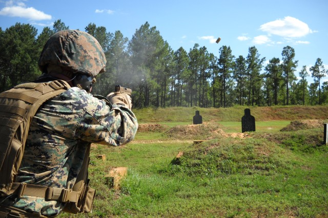 A Marine Warfighter shoots the XM17 Modular Handgun System on the Rapid Fire/Weapon Transition Fire Course during the Modular Handgun System initial operational test at Fort Bragg, North Carolina Sep. 9.